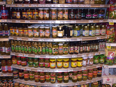 Canned food and jars on shelf
